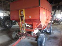 j-m-gravity-box-225-bushels-on-running-gear-11l15-tires-w-soya-unverfeth-auger-12-ft